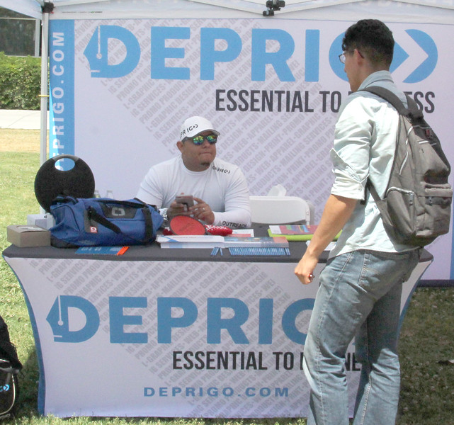 A representative for digital marketing business Deprigo hosts a booth in the CSS Lawn.