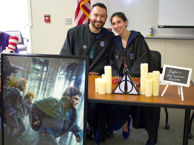 Professors Matt Jones and Savannah Andrasian host a booth with information about the English 2 Harry Potter course.