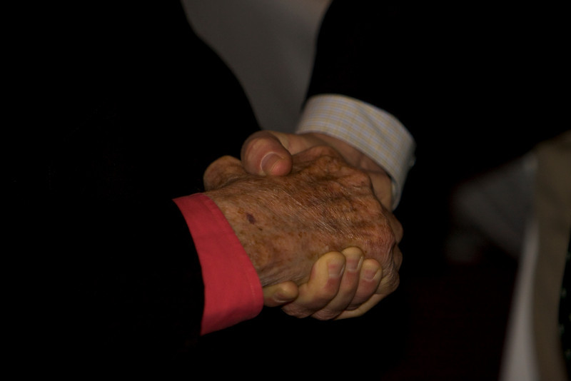 Bob Fitzgerald  shakes hands with Cliff Robertson, actor and aviator, who is this year's commencement speaker.