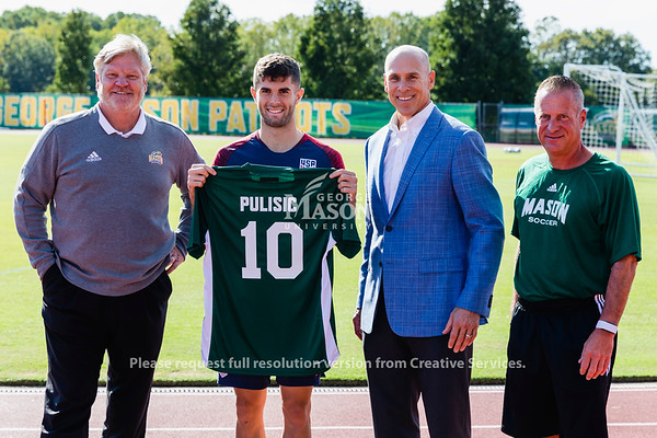 United States Men's National Soccer team midfielder Christian Pulisic (second from left) is photographed with George Mason University Men's Soccer Coach Greg Andrulis (far left), Director of Athletics Brad Edwards (second from right) and Women's Soccer Coach Todd Bramble.  Photo by Lathan Goumas/Office of Communications and Marketing   Photo Taken:Thursday, October 10, 2019