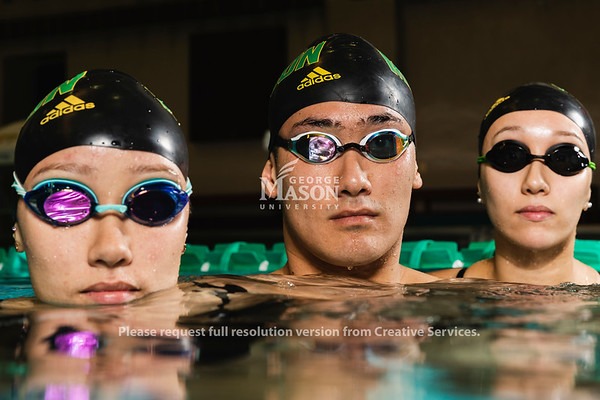 George Mason University Swim Team members and triplets Sophie, Tim and Mia McKinley.  Photo by Lathan Goumas/Office of Communications and Marketing   Photo Taken:Saturday, November 16, 2019