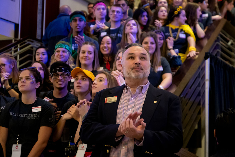 Felix Alonso, director of Student Philanthropy  looks around the great hall during the opening ceremonies of the 2019 BuckeyeThon dance marathon at the Ohio State University (Katherine Seghers - Ohio State University Office of Student Life)