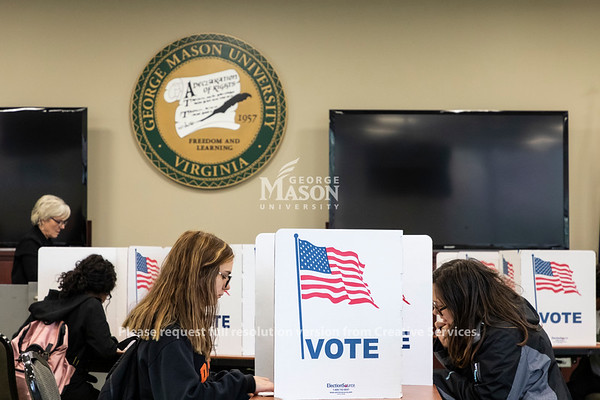 People vote in Merten Hall. Photo by Lathan Goumas/Strategic Communications