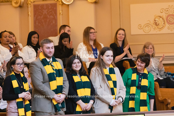 A delegation from George Mason University, including President Anne Holton, stands to be recognized in the House of Delegates during Mason Lobbies Day in Richmond.  Photo by Lathan Goumas/ Office of Communications and Marketing