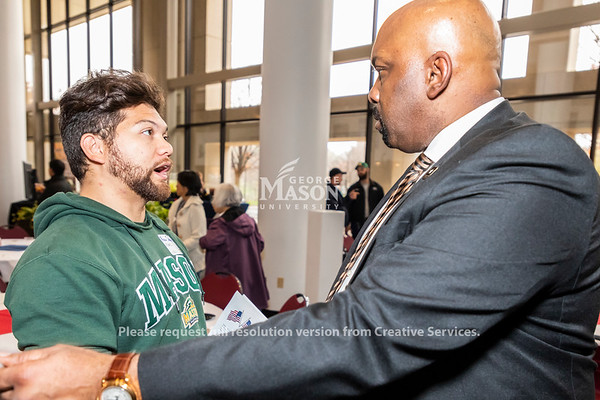 George Mason senior and U.S. Marine Corps veteran Rich Strauss talks with retired U.S. Army Colonel Reginald Allen following the 2018 Veterans Day luncheon at George Mason University. Photo by Lathan Goumas/Strategic Communications