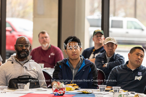 People listen as retired U.S. Army Colonel Reginald Allen speaks during the 2018 Veterans Day luncheon at George Mason. Photo by Lathan Goumas/Strategic Communications