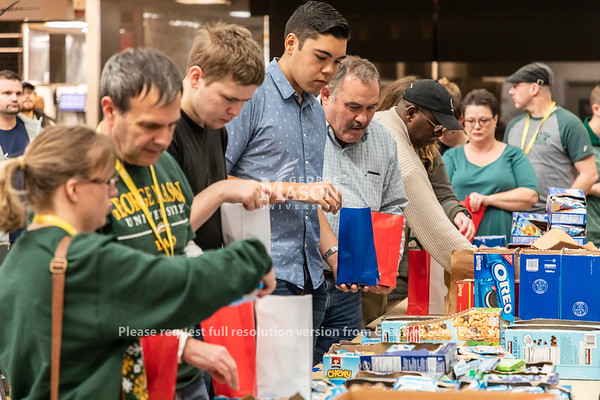 Members of the George Mason community make care packages for wounded veterans. Photo by Lathan Goumas/Strategic Communications