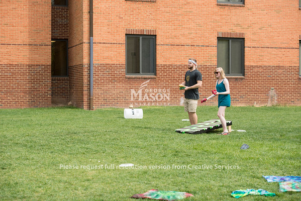 Students enjoying the warm weather at Parkapalooza in President's Park. (Bethany Camp/Creative Services/George Mason University)