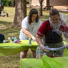 University of West Florida students work on their tie-dye tee shirts Tuesday, April 3, 2018 during the Tie-Die in the grass event on the PARGO grass area at UWF.