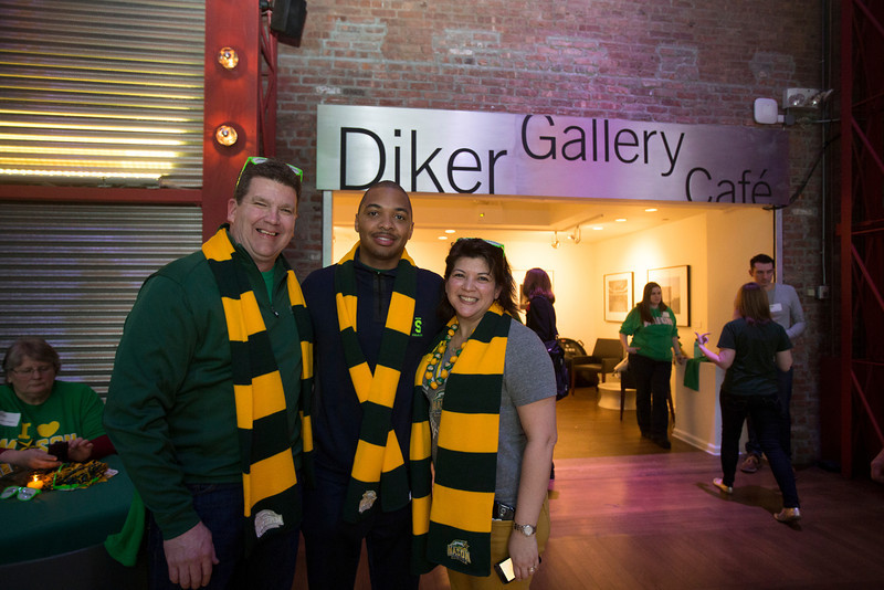 Lamar Butler, center, poses with Rob Walters and Jen Shelton during the Ignite Your Mason Spirit Reception at the Brooklyn Academy of Music - Lepercq Space in Brooklyn, NY. George Mason Patriots play against the Fordham Rams in the Opening Round of the 2014 Atlantic 10 Men's Basketball Championship. Photo by Craig Bisacre/Creative Services/George Mason University