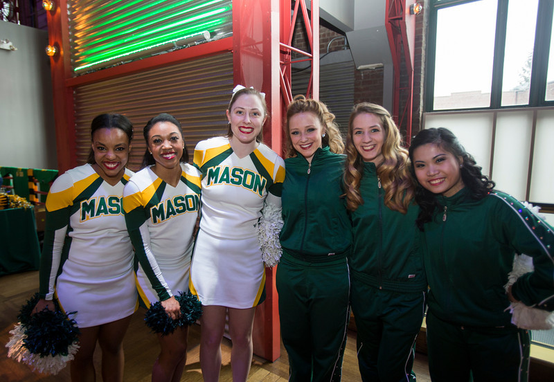 The Mason Cheerleaders hype up the crowd during the Ignite Your Mason Spirit at the Brooklyn Academy of Music - Lepercq Space in Brooklyn, NY. George Mason Patriots play against the Fordham Rams in the Opening Round of the 2014 Atlantic 10 Men's Basketball Championship. Photo by Craig Bisacre/Creative Services/George Mason University