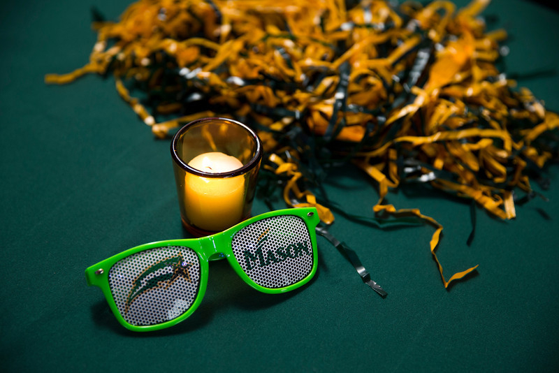 Mason sunglasses during the Ignite Your Mason Spirit Reception at the Brooklyn Academy of Music - Lepercq Space in Brooklyn, NY. George Mason Patriots play against the Fordham Rams in the Opening Round of the 2014 Atlantic 10 Men's Basketball Championship. Photo by Craig Bisacre/Creative Services/George Mason University