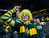 Mason fans rock the green and gold as the George Mason Patriots play against Fordham Rams in the Opening Round of the 2014 Atlantic 10 Men's Basketball Championship at the Barclays Center in Brooklyn, NY. Photo by Craig Bisacre/Creative Services/George Mason University