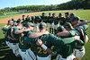 The men's baseball team huddles.  Photo by Craig Bisacre/Creative Services/George Mason University