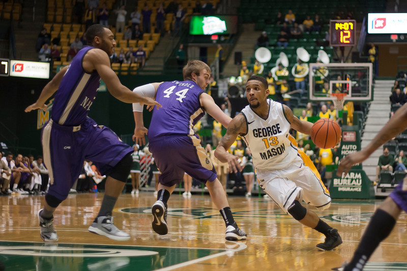 George Mason Patriots guard Corey Edwards (13) drives to the basket in the second half against James Madison Dukes at the Patriot Center on Tuesday, January 15, 2013. Photo by Craig Bisacre/Creative Services/George Mason University
