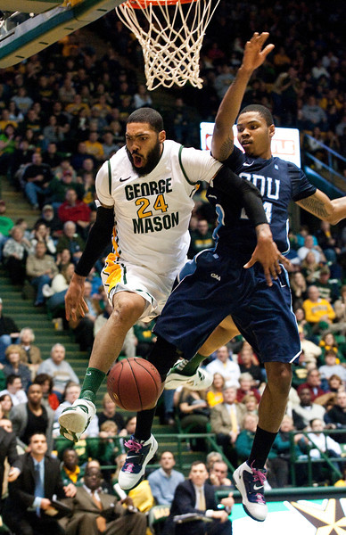 Forward Ryan Pearson is fouled by ODU during the Mason Homecoming 2012 basketball game at the Patriot Center, Fairfax Campus. Photo by Alexis Glenn/Creative Services/George Mason University