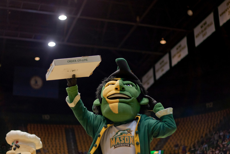 The George Mason Patriot offers a free pizza to fans during a timeout in the second half against James Madison Dukes at the Patriot Center on Tuesday, January 15, 2013. Photo by Craig Bisacre/Creative Services/George Mason University
