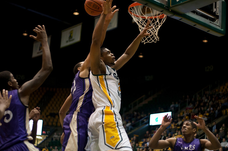 George Mason Patriots forward Johnny Williams (2) goes up for a lay up in the first half against James Madison Dukes at the Patriot Center on Tuesday, January 15, 2013. Photo by Craig Bisacre/Creative Services/George Mason University