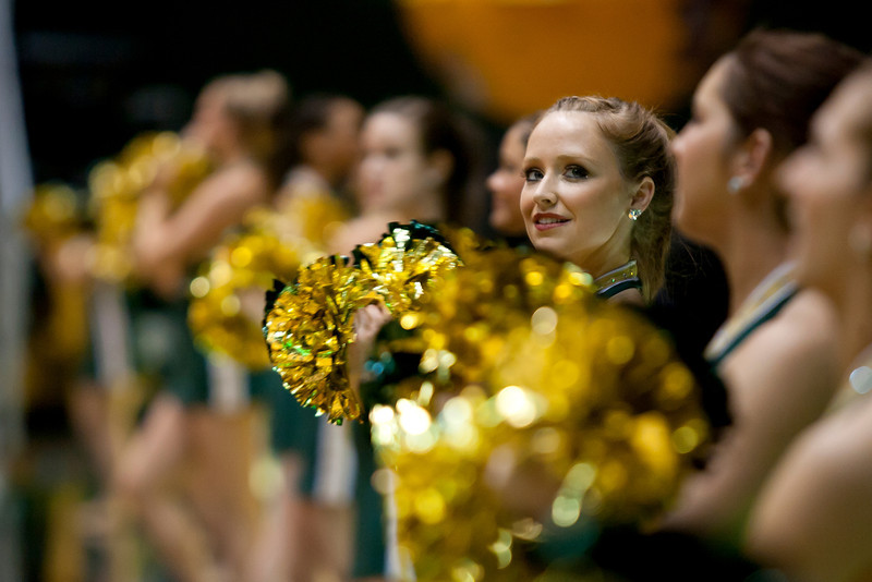 A Masonette looks off into the student section for the start of the second half against James Madison Dukes at the Patriot Center on Tuesday, January 15, 2013. Photo by Craig Bisacre/Creative Services/George Mason University