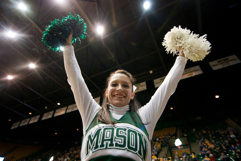 A George Mason cheerlead performs during halftime of George Mason Patriots against James Madison Dukes men's basketball game at the Patriot Center on Tuesday, January 15, 2013. Photo by Craig Bisacre/Creative Services/George Mason University