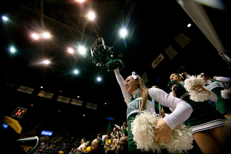 George Mason cheerleaders cheer on their Patriots before the start of the second half against James Madison Dukes at the Patriot Center on Tuesday, January 15, 2013. Photo by Craig Bisacre/Creative Services/George Mason University