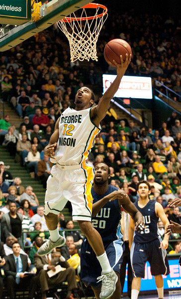 Forward Vaughn Gray (12) goes for a layup against ODU during the Mason Homecoming 2012 basketball game at the Patriot Center, Fairfax Campus. Photo by Alexis Glenn/Creative Services/George Mason University