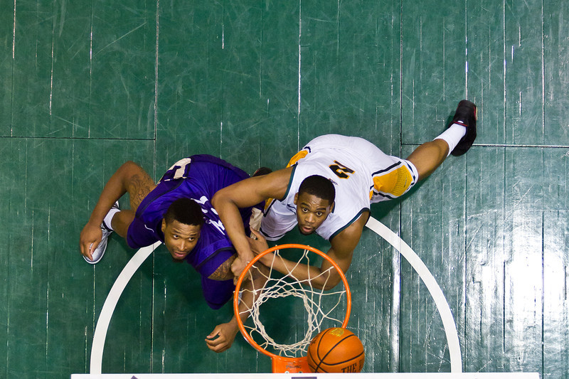 George Mason Patriots forward Johnny Williams (2) fights against James Madison Dukes forward Rayshawn Goins (33) for a rebound in the second half at the Patriot Center on Tuesday, January 15, 2013. Photo by Craig Bisacre/Creative Services/George Mason University