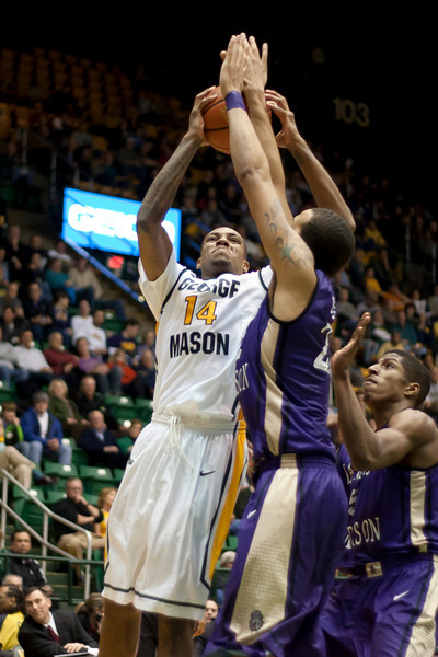 George Mason Patriots forward Anali Okoloji (14) drives to the basket in the second half against James Madison Dukes at the Patriot Center on Tuesday, January 15, 2013. Photo by Craig Bisacre/Creative Services/George Mason University