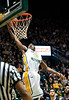 Vaughn Gray (12) dunks against ODU during the Mason Homecoming 2012 basketball game at the Patriot Center, Fairfax Campus. Photo by Alexis Glenn/Creative Services/George Mason University