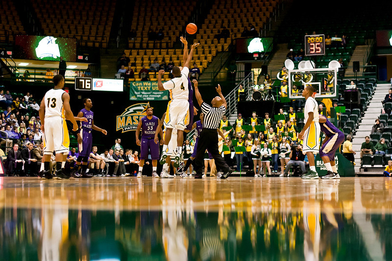 James Madison Dukes win the starting tipoff against George Mason Patriots at the Patriot Center on Tuesday, January 15, 2013. Photo by Craig Bisacre/Creative Services/George Mason University