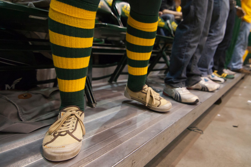 A George Mason fan shows off their shirt with green and gold socks against James Madison Dukes at the Patriot Center on Tuesday, January 15, 2013. Photo by Craig Bisacre/Creative Services/George Mason University