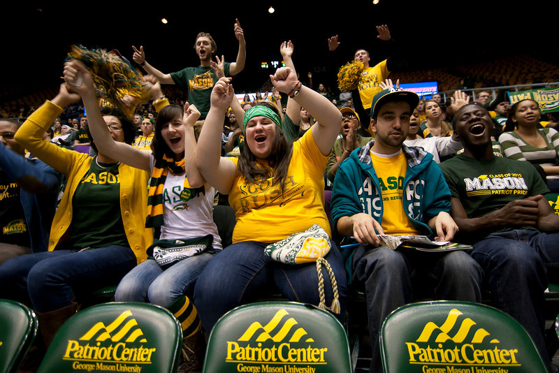 George Mason students cheer before the start of the second half against James Madison Dukes at the Patriot Center on Tuesday, January 15, 2013. Photo by Craig Bisacre/Creative Services/George Mason University