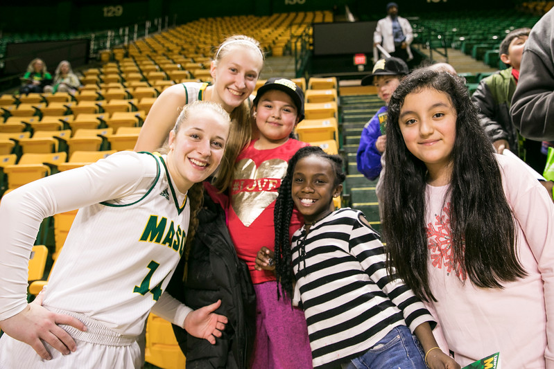 Women's Basketball team signs autographs for elementary school kids visiting during the George Mason University women's basketball game against the University of Richmond.   Photo by:  Ron Aira/Creative Services/George Mason University