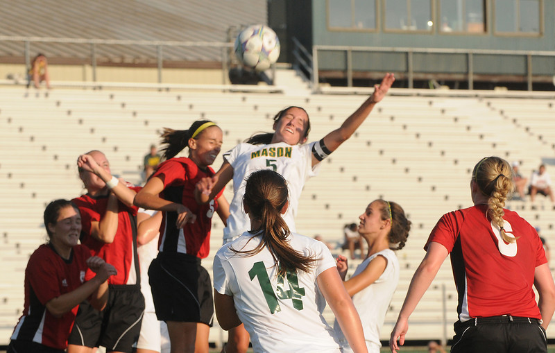 e110914139 - Women's soccer player Mary Kate Lowry wins the header