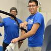 Students Lucio Cruiz Left and David Lopez do their regular maintain equipment in Dugan Wellness Center.