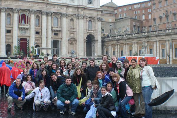 Campus Ministry in Vatican City with St. Peter's Basilica in the background.