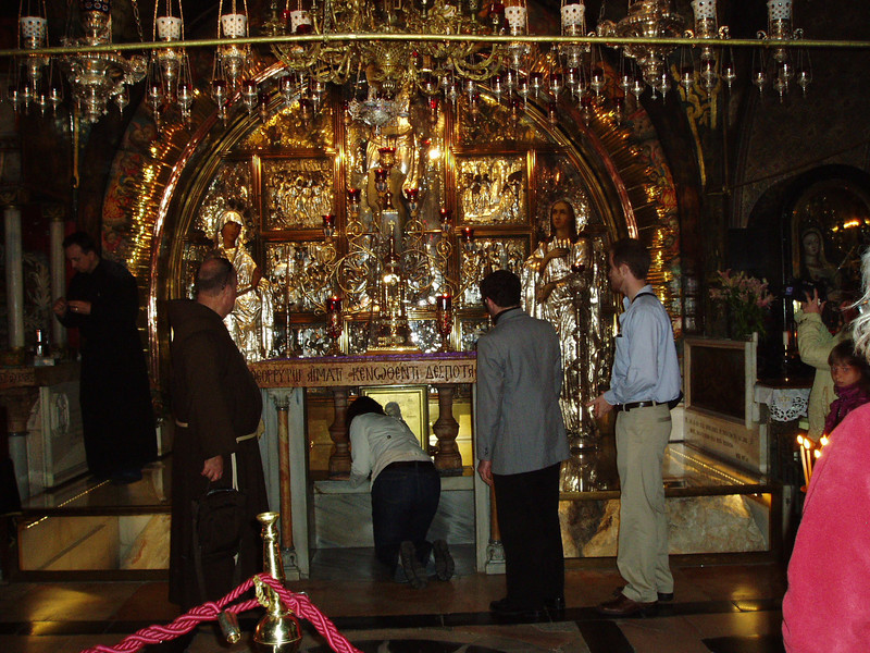 Group members pause to touch the rock of Calvary at the Church of the Holy Sepulchre in Old City Jerusalem in May 2010.