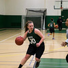 Bonnie Bishop (center) with coach and GMU alumna Naja Brown playing defense during a practice of the George Mason women's basketball club after transferring and finding no club outlet for her basketball passion.  Photo by Craig Bisacre/Creative Services/George Mason University