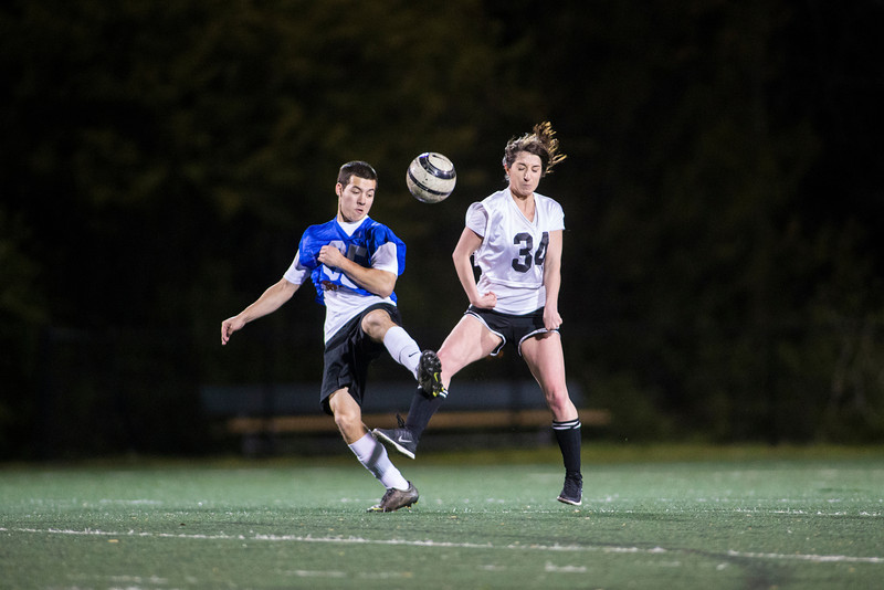 Students play coed intramural soccer on the RAC Field. Photo by Craig Bisacre/Creative Services/George Mason University