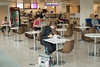 Students sit at Freshens Smoothies inside the Recreation and Athletic Complex at Fairfax Campus. Photo by Alexis Glenn/Creative Services/George Mason University