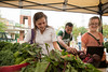 Students buy fresh, organic, produce at the Southside Farmers' Market. The produce, sourced locally from regional farms, is also used at Mason's on-campus dining facilities. Photo by Alexis Glenn/Creative Services/George Mason University