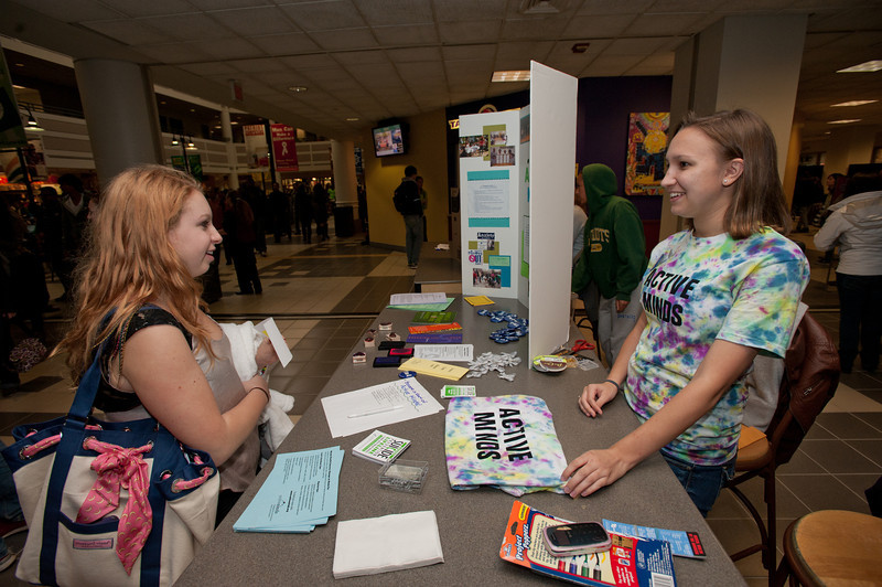 111003501 - Mason student Katy Weigel, a junior, Math/Sociology major and President of the new student group Active Minds, host a booth on National Day Without Stigma at the Johnson Center. Photo by Alexis Glenn