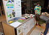 111003507 - Mason students Seth Dunoff, sophomore, Sociology Major, hosts a booth for the new student group Active Minds on National Day Without Stigma at the Johnson Center. Photo by Alexis Glenn