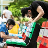 Students paint their club and organization spirit benches.  Photo by:  Ron Aira/Creative Services/George Mason University