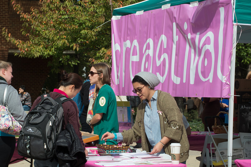Students learn about health screenings during breast cancer awareness month at a Breastival event sponsored by The Office of Alcohol, Drug, and Health Education. Photo by Evan Cantwell/Creative Services/George Mason University