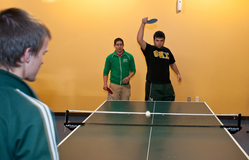 Students play ping-pong at Corner Pocket in The Hub on Fairfax Campus.
