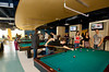 Students play pool at Corner Pocket in The Hub on Fairfax Campus.