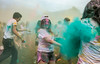 "Students participate in ""Holi Moli"".  Holi is the Hindu festival of colors that celebrates the triumph of good over evil and serves as a holiday to bring the community together.  Photo by Craig Bisacre/Creative Services/George Mason University"