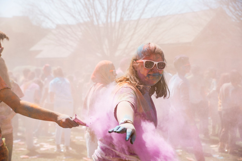 Students celebrate the Hindu festival Holi by participating in Holi Moli, which is sponsored by the GMU Indian Student Association. Photo by Bethany Camp/Creative Services/George Mason University