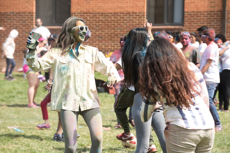 Students celebrate Holi Moli in President's Park. Photo by Bethany Camp/Creative Services/George Mason University
